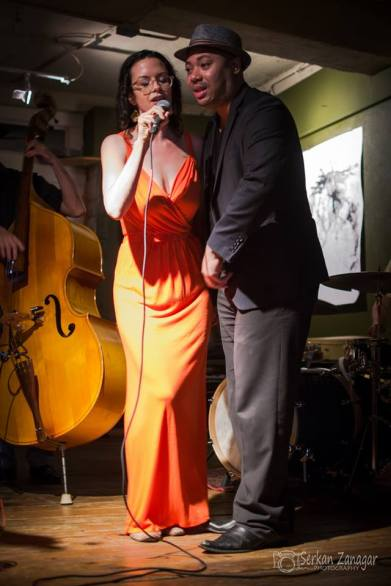 Stefanie Pepping and Damon K. Clark singing a duet